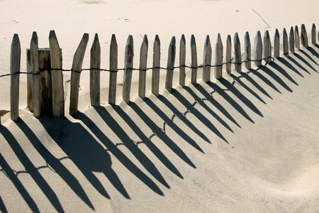 Wooden barrier on a sand dune on the vendean coast
