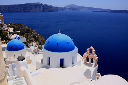 Typical church of Santorin with blue roof on blue background