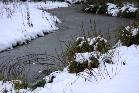 River in winter after a snowfall photo