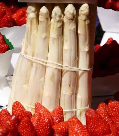 Strawberries and asparaguses Stock Photo