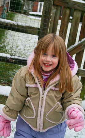 grandaughter: Little girl enjoying the snow Stock Photo