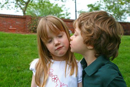 A boy kissing a girl photo