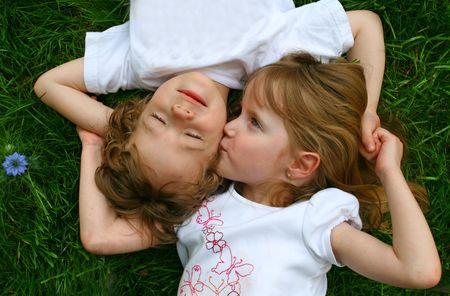 cheek to cheek: Kissing a boy Stock Photo