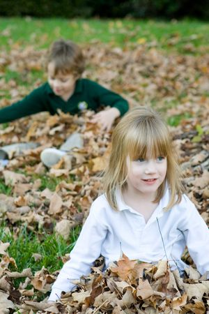 Playing in the autumn leaves photo