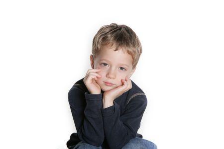 sad face: Four year old boy with a sad face