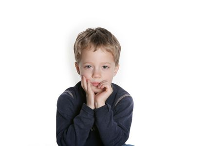four year old: Four year old boy looking pensive