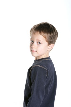 brooding: Cute four year old boy against a white background