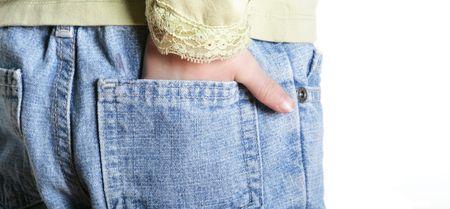 Childs hand in her back pocket