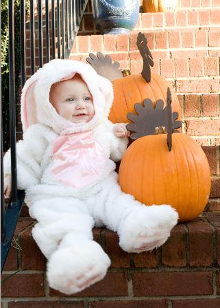 A little girl in her Halloween rabbit costume photo