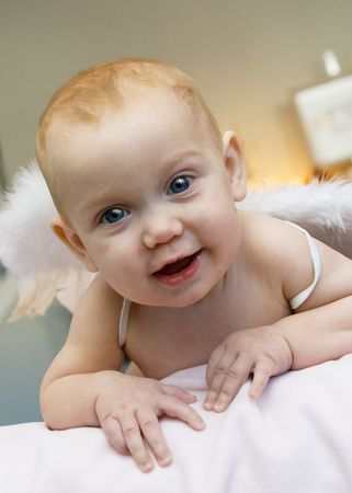 A blue eyed baby girl with angel wings