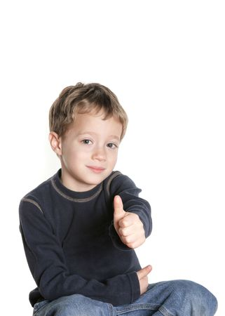 Smiling boy giving thumbs up sign Stock Photo