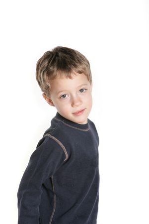 A sweet boy looking at the camera on white background Stock Photo