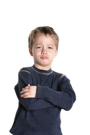 Small boy pouting on a white background