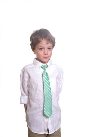 Small boy wearing a tie on a white background