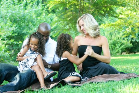 ethnic mix: A loving mixed race family enjoying the park