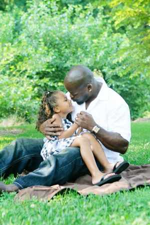 A father and his mixed race daughter enjoying the park  Stock Photo - 5559837