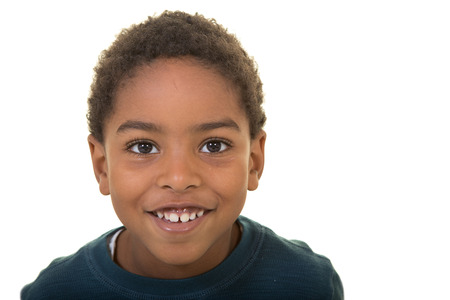 Portrait of a school aged boy isolated on white