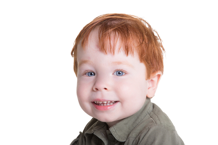 Portrait of a red headed toddler isolated on white Banco de Imagens
