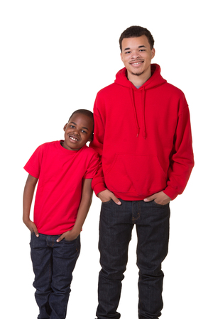 A teenager and his younger brother isolated on white