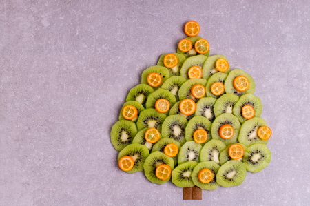 Christmas tree made of kiwi and kumquat