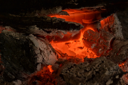 Ember or a piece of wood or coal that continues to burn after a fire has no more flames