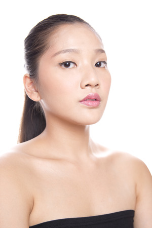 Asian young beautiful woman with flawless complexion touching face with both hands Stock Photo