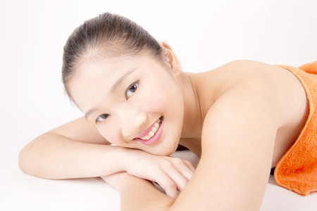 flawless: Asian young beautiful smiling woman with flawless complexion relaxing