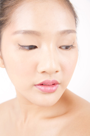 Asian young beautiful woman with flawless complexion close up