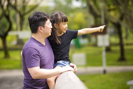4 people: Asian father and daughter having fun in the park Stock Photo