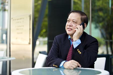 real leader: Asian businessman talking on smart phone