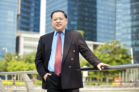 real leader: Asian businessman smiling portrait