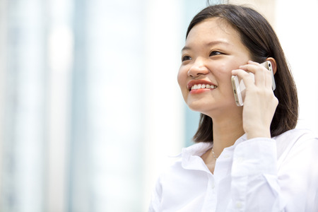 real leader: Asian young female executive talking on smart phone Stock Photo