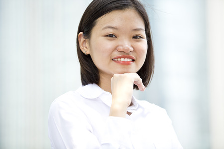 real leader: Asian young female executive smiling portrait Stock Photo
