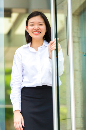 Young Asian female executive smiling portrait