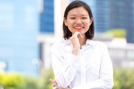 female executive: Young Asian female executive smiling portrait