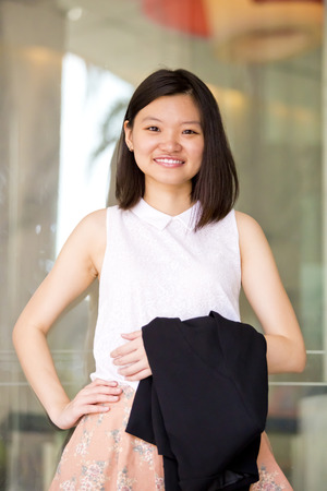 real leader: Young Asian female business executive smiling portrait Stock Photo