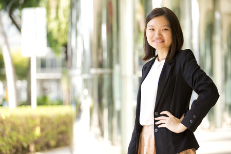 Young Asian female business executive smiling portrait Stock Photo
