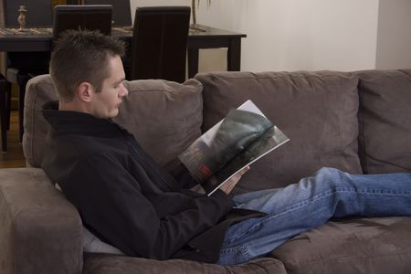Guy reading a magazine