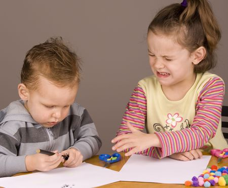 Girl crying because her brother took her pen
