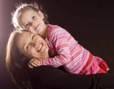 Mother and her daughter hugging each other Stock Photo - 5435662