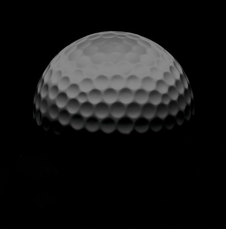 Golf ball illuminated from above with black background Stock Photo