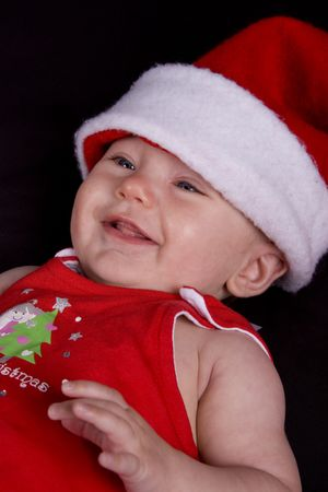Baby girl dressed up in santa hat and red dress Stock Photo - 5971227