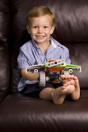 little boy with his favourite aeroplane toy photo