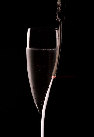 Silhouette of a champagne bottle with glass of bubbly Archivio Fotografico