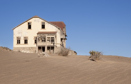 Ruined building in the ghost town of Kolmanskoppe, Luderitz, Namibia Stock Photo - 7040188