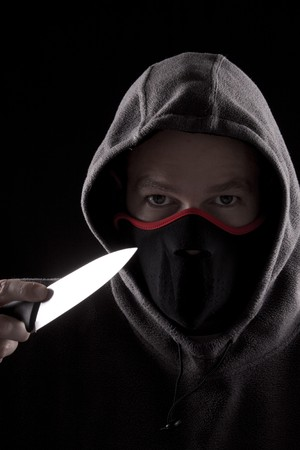 man with knife and hoody, concept of danger photo