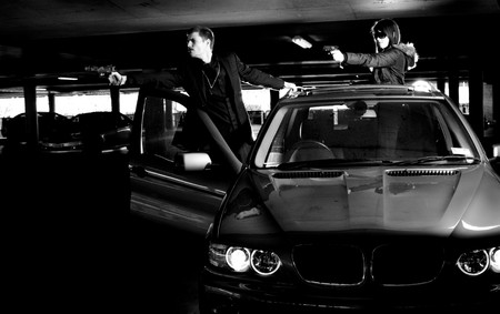 Bonnie and Clyde in a shootout within a parking lot Stock Photo - 8063135