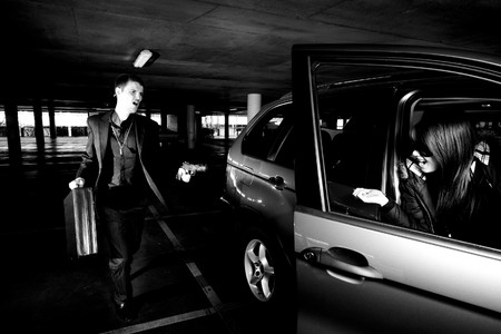 car theft: Guy with gun car-jacks a girl in a car