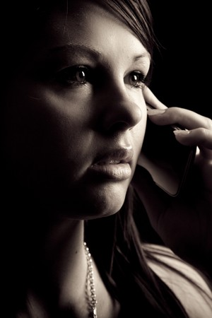 Young woman speaking on her mobile phone photo
