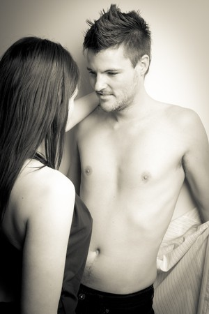 Two young adults making out photo